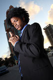 Secret agent man. Young businessman secret agent using his hands as a make believe gun Stock Image