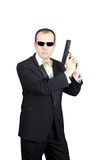 Secret Agent Pose. Secret Agent holding gun prepared to shoot royalty free stock images