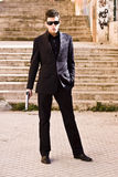 Secret agent ready. Male model performing secret agent with gun royalty free stock photos
