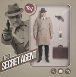 The secret agent realistic doll. Secret agent realistic doll, accessories and toy see through packaging with character pointing a gun Stock Photos