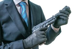 Secret agent or spy holds pistol with silencer in hands. Isolated on white. Royalty Free Stock Photography