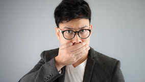 Secret of Asian man business. Asian businessman in black suit royalty free stock photo