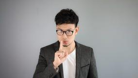 Secret of Asian man business. Asian businessman in black suit stock photos