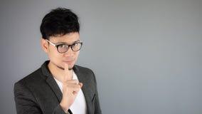 Secret of Asian man business. Asian businessman in black suit stock image