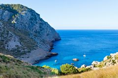Secret beach - wild coast of Mallorca, Spain, Balearic Islands. Artistic sunrise and dusk landascape. Secret lonely beach bay - wild coast of Mallorca, Spain royalty free stock photos