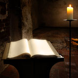 Secret book. Open book with blank pages and candle Stock Images