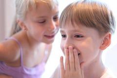 Secret children`s talk Stock Photo