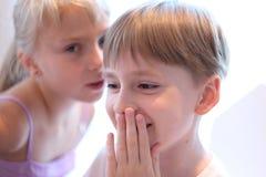 Secret children`s talk Stock Images