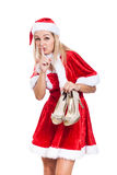 Secret Christmas woman with shoes. Secret woman in Christmas costume holding high heel shoes, isolated on white background Royalty Free Stock Photo