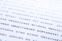 Secret codes. Printed on paper. Narrow depth of field, blue toned effect Royalty Free Stock Photos