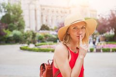 Secret concept, finger on the lips, portrait of woman. Female secret concept, finger on the lips, portrait of woman traveling royalty free stock images
