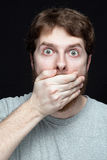 Secret concept - man amazed by gossip news. Secret concept - young man amazed by gossip news Royalty Free Stock Photos