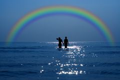 Secret date under rainbow Stock Photo