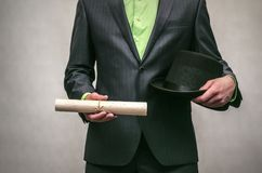 The spy. Secret service. Detecive agent. Secret detective agent in suit and hat holds in hand secret compromising evidence letter isolated on white. Secret Royalty Free Stock Images