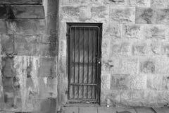 The Secret Door. A secret door is hidden and locked under a bridge Stock Photo