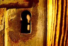 Secret door mystery. Mysterious old keyhole door close-up,  concept of mystery Royalty Free Stock Photo