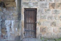 The secret door. A secret door sits in the wall under a bridge, locked Royalty Free Stock Photography