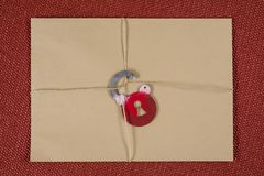 A secret envelope, a parcel bound with a rope, with symbolic lock. Open the lock. stock images
