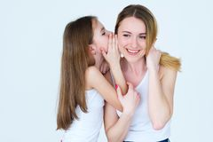 Secret family trust relationship daughter whisper. Secret sharing. family trusting relationship. daughter whispering something into her mothers ear Stock Images