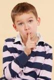 The secret. Finger over mouth. Psst. Stock Images