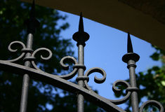 Secret garden. Ornate gate leading into a park/garden royalty free stock photography