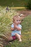 The Secret Garden. Young girl exploring a garden Stock Photo