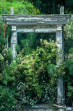 Secret Garden. Old arch/door frame in overgrown garden stock image