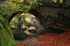Secret garden. The secret garden – landscaping. Old stone bridge and stairs Royalty Free Stock Images