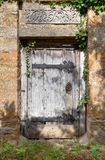Secret garden door. Old doorway to Cotswold manor house garden, Warwickshire, England Royalty Free Stock Photography