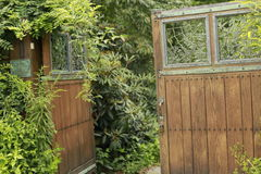 Secret Garden. Inviting gate into a green garden Stock Photos