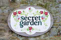 Secret garden sign. On weathered stone wall Royalty Free Stock Image