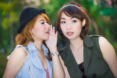Secret.Gossiping woman Royalty Free Stock Photos