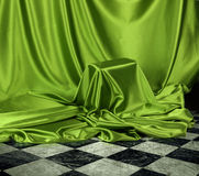 Secret green mystery. Something secret veiled under green satin silky cloth fabric Royalty Free Stock Photography