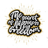 The secret of happiness is freedom - lettering, calligraphic letters. Stamp for t-shirts design, cards, posters, banners. Motivational and inspirational quote Royalty Free Stock Image