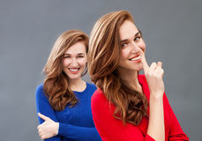 Secret in happiness with the same gorgeous young woman Stock Photography