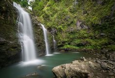 Secret Hawaiian waterfall deep in the Jungles of Maui stock photography