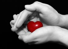 Secret heart. Woman hands holding a heart Royalty Free Stock Photos