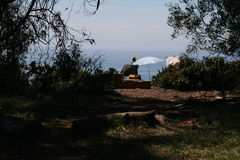 Secret Hideaway in Santa Barbara. A woman sets up to relax near the beach in Santa Barbara Stock Photo