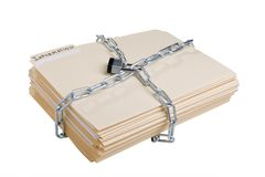 Secret information. Stack of manila folders wrapped with a metal chain and closed with a lock Stock Photography