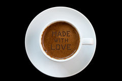 The secret ingredient of Greek coffee is love. (Made with love written with 130 bubbles. Photo isolated on black background, upper view, copy space Royalty Free Stock Image