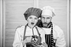 Secret ingredient by recipe. cook uniform. couple in love with perfect food. Menu planning. culinary cuisine. Family royalty free stock photos
