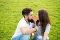 Secret kiss. Man bearded hipster and pretty woman in love. Summer vacation. Happy together. Couple in love cheerful. Youth booth props. Emotional couple stock image