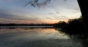 Secret Lake park at sunset in Casselberry Florida. Secret Lake Park at sunset located on Triplet lake drive,  Casselberry Florida Royalty Free Stock Photos