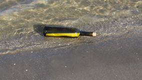 Secret message in the bottle on the beach Royalty Free Stock Photography