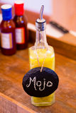 Secret Mojo BBQ Sauce. Bbq sauce with a yellow color and a label of mojo at a wedding reception catering bar royalty free stock photography