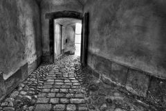 Secret passage. Medieval tunnel. Black and white image Royalty Free Stock Photography