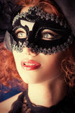 Secret. Portrait of a beautiful smiling woman in carnival mask royalty free stock photography