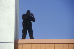 Secret Service agent. On rooftop security duty during Clinton/Gore 1992 campaign royalty free stock photography