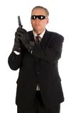 Secret service agent. Secret service agent wearing sunglasses holding a gun. Isolated on white royalty free stock photos
