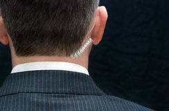 Secret Service Agent, Behind. Close-up of a secret service agent, behind royalty free stock photo